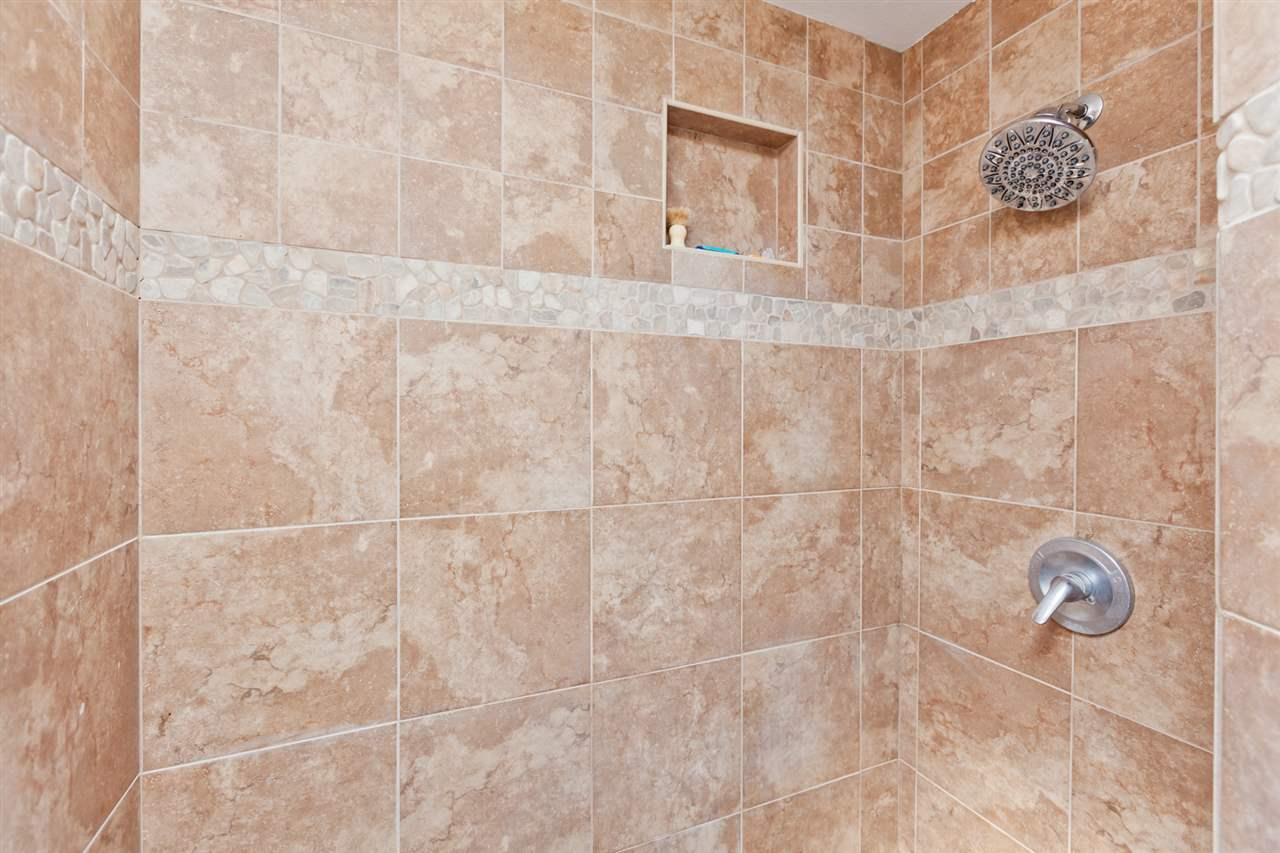 The Master Step-In Shower Boasts a Pebbled Floor!