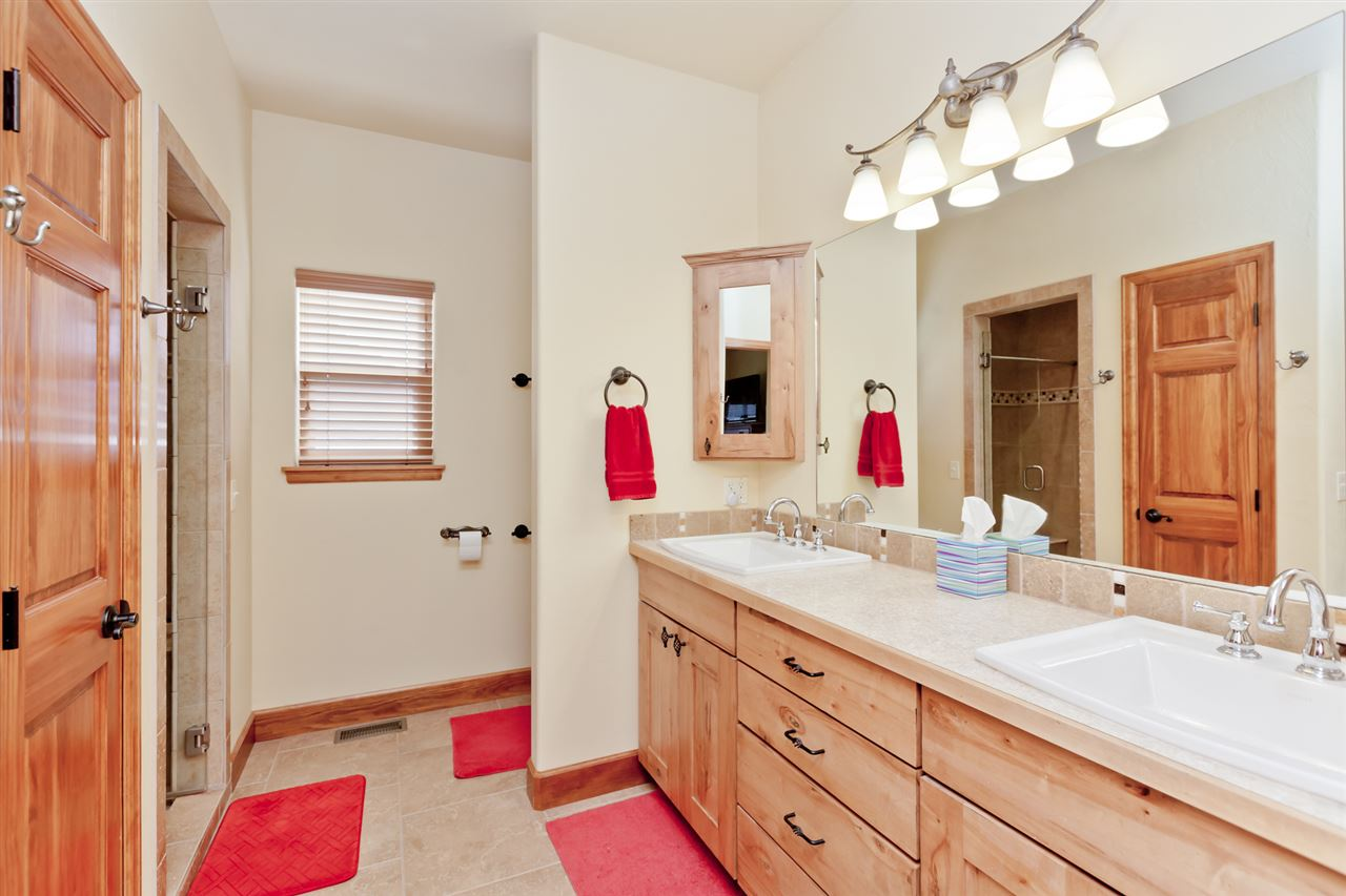 Dual Sink Vanities and a Master Step-in Shower!