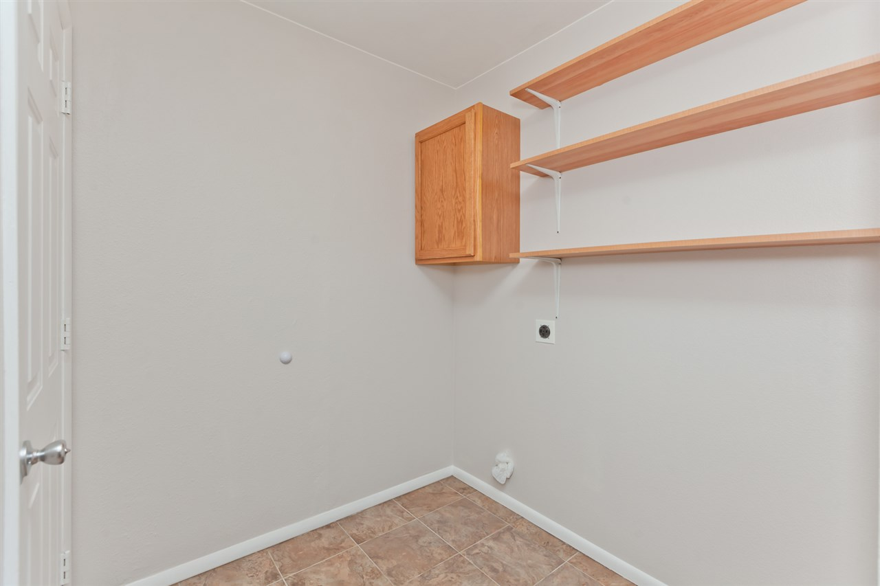 Laundry Room has Storage & Direct Garage Access!