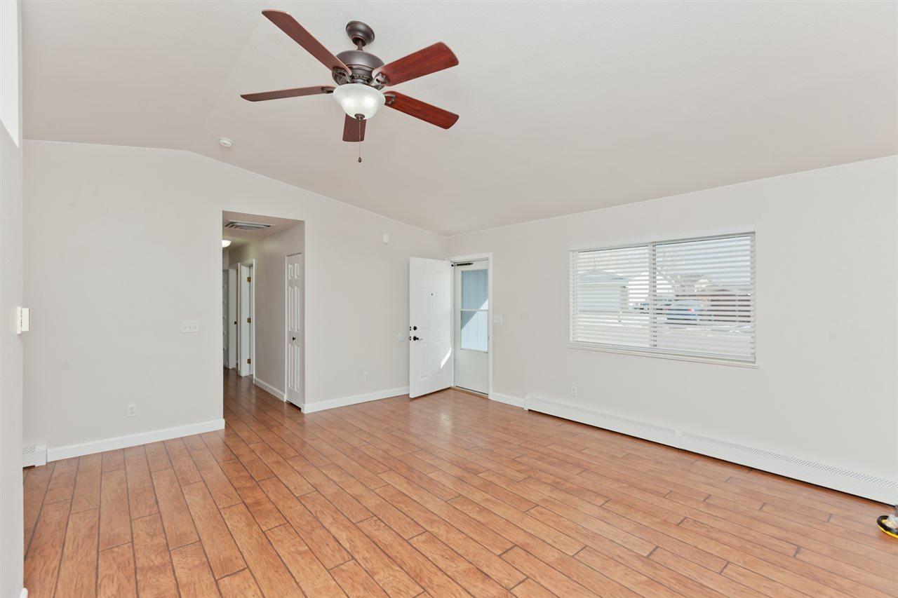 Spacious Living Room Clad in Wood Laminate Floors!