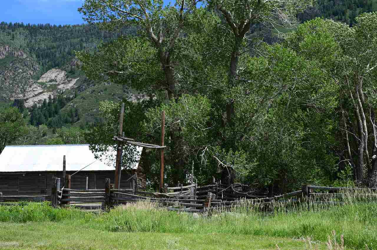 A barn and corral sit on the land!