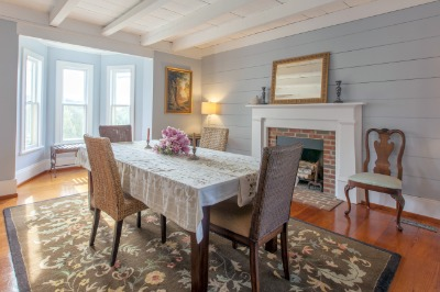 Inviting dining room with shiplap wall boards