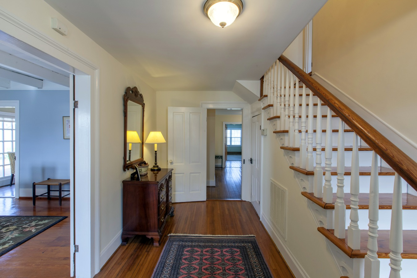 Inviting entry hall with heart pine stairs