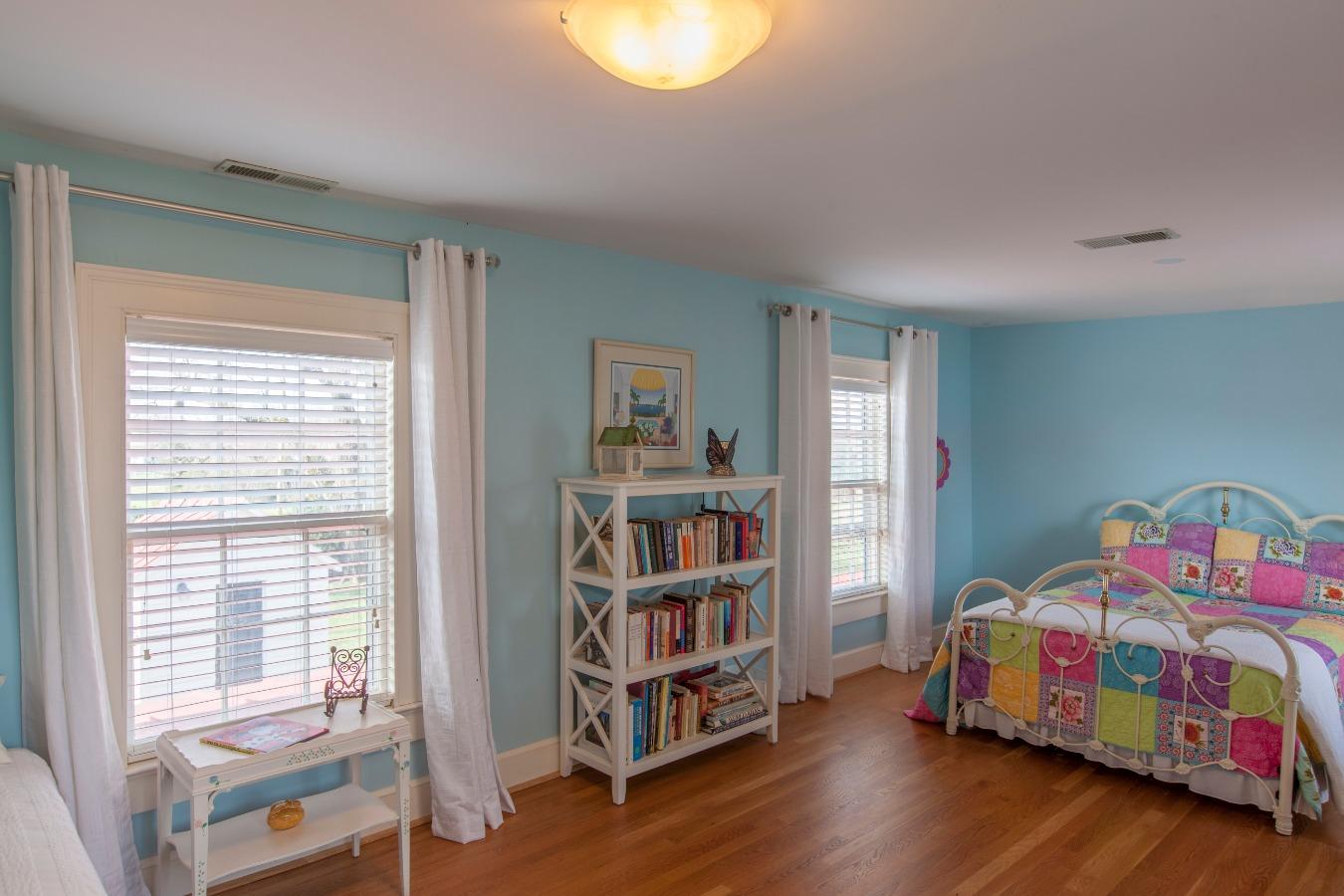 Bedroom has a cedar walk-in closet and full bath with ceramic tile floor