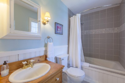 Master bath with ceramic tile and wainscoting