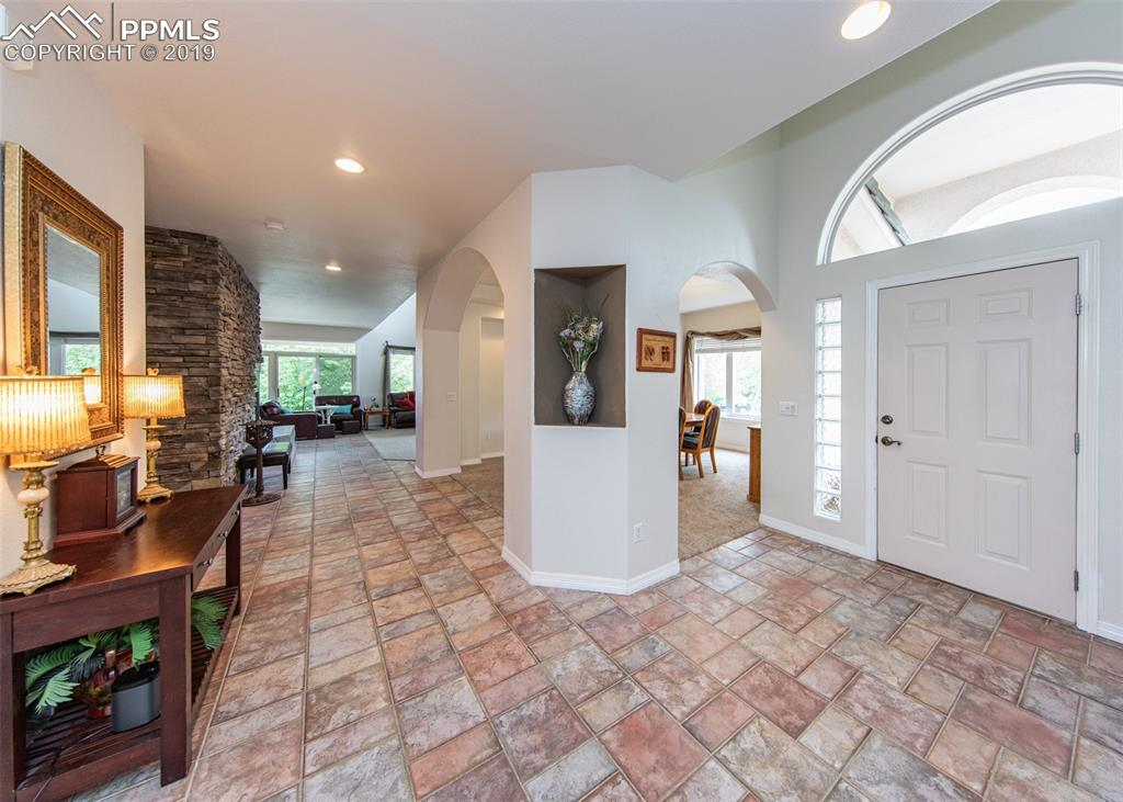 Entry with arched doorways into dining room