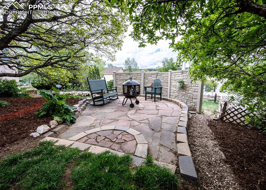 Private flagstone patio with fire pit