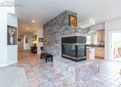 3-sided gas log fireplace between family room & kitchen