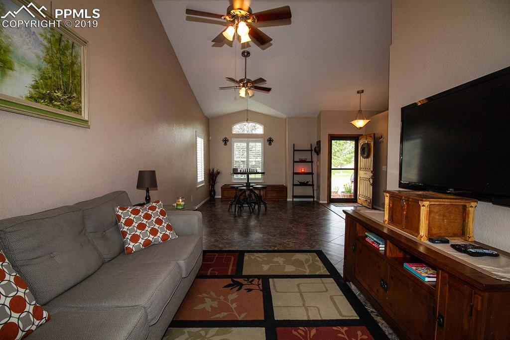 Vaulted living room with double ceiling fans