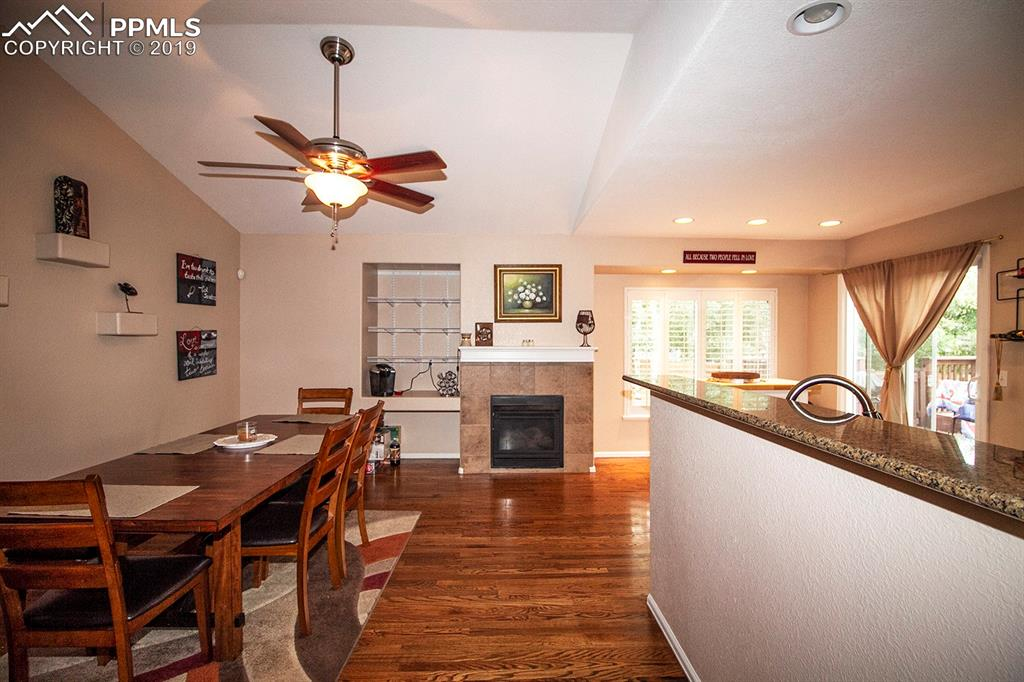 Dining room with fireplace & kitchen breakfast bar