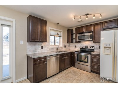 Updated kitchen with granite and tile