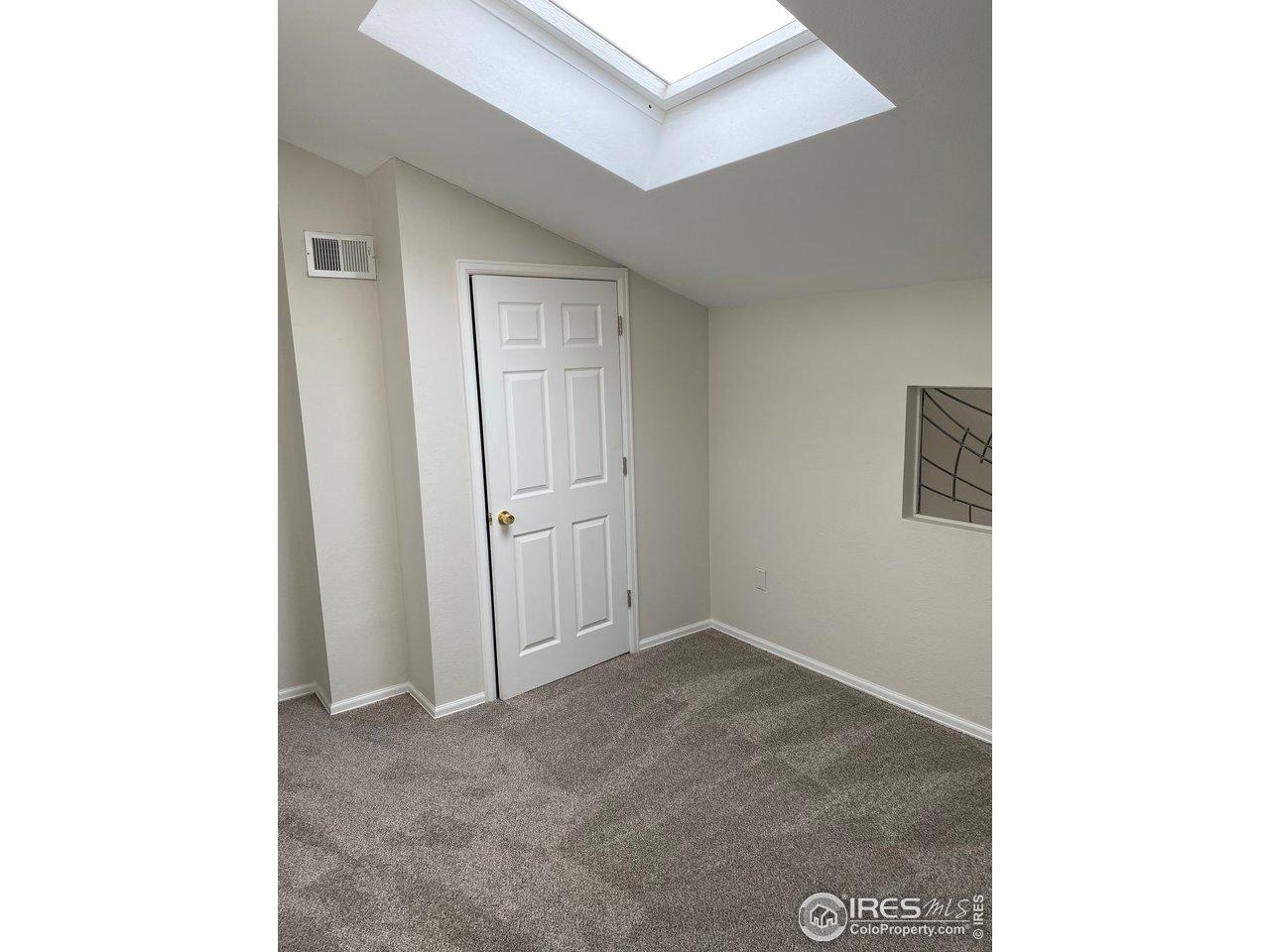Upper level bedroom/study with closet