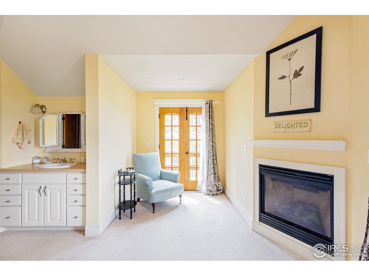 Upper Bedroom 3 with fireplace and private balcony