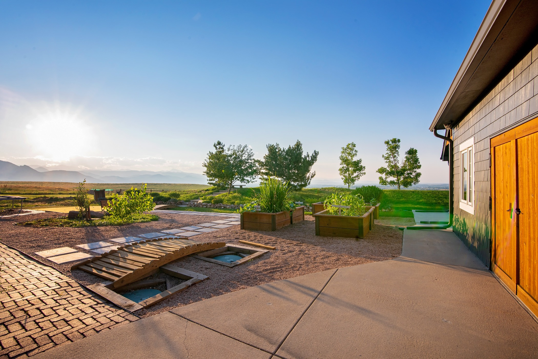 Sunny backyard with many spaces