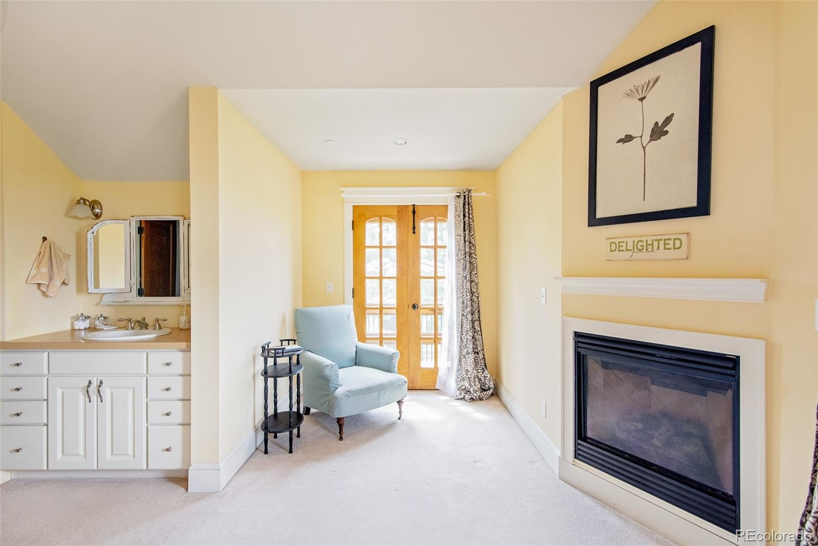 Upper Bedroom w/fireplace and private balcony