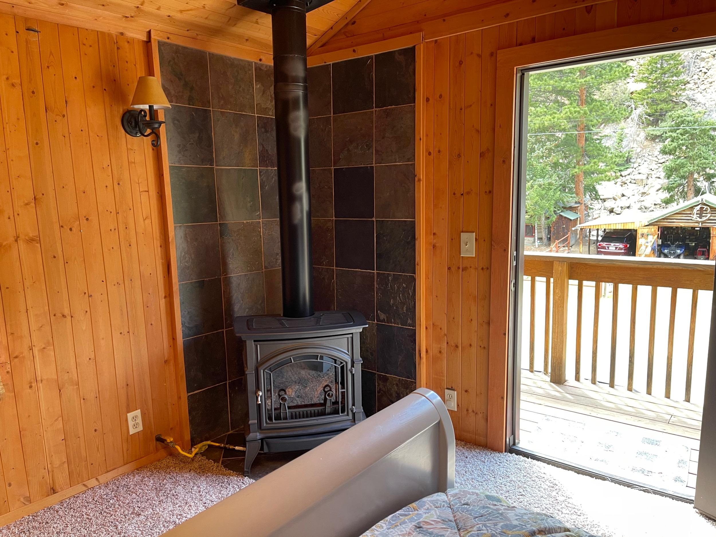 Freestanding gas fireplace in bedroom
