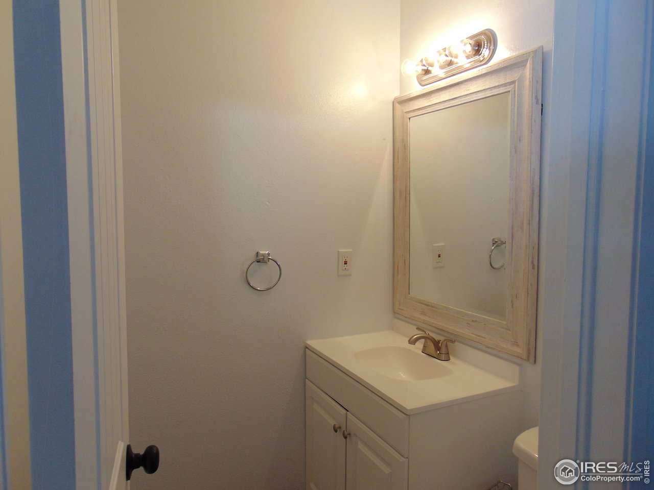 New vanity, mirror and toilet in the half bath