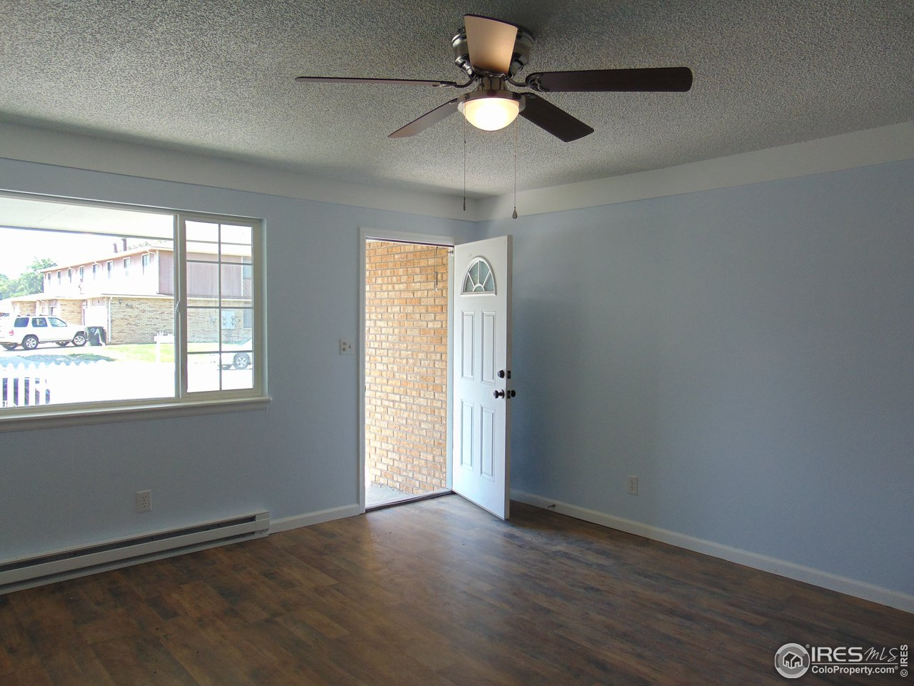 Living room with lots of light. Notice new flooring throughout.
