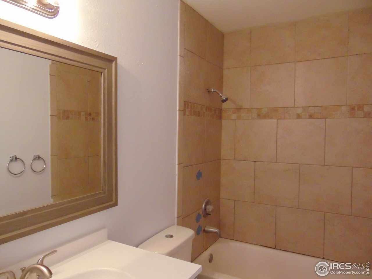 Main bath new vanity, new toilet and fixtures.