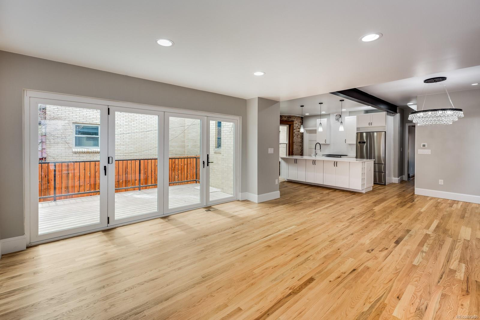 Accordion door creates a 12-foot wide opening to the deck.