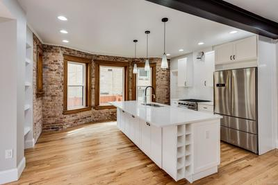 A kitchen for cooking, entertaining, dining and relaxing.