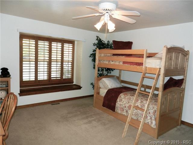 Very large bedroom on the main level with plantation shutters an