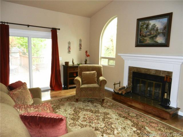 Family room with cozy wood-burning fireplace on the main level w