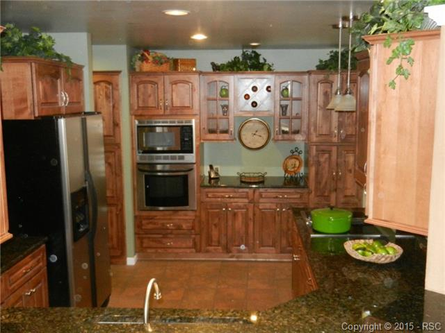 Another view of the large, updated kitchen with beautiful slow-c