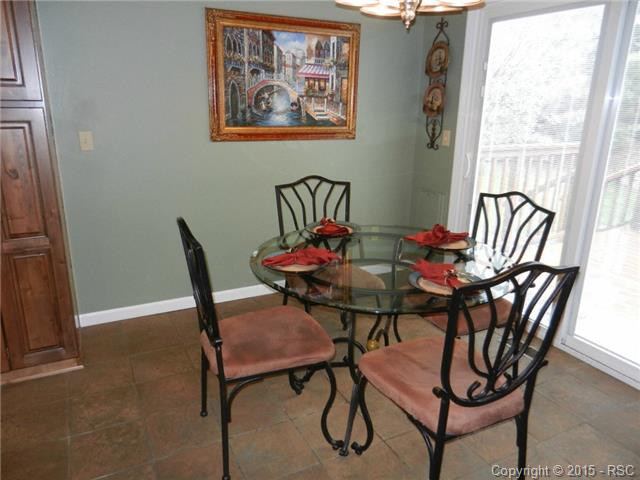 Eat-in area in kitchen overlooking the gorgeous backyard