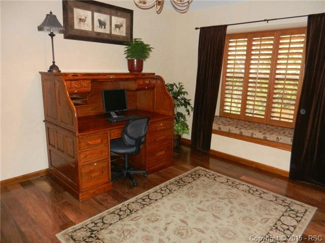 Bedroom on the main with wood flooring makes a perfect office