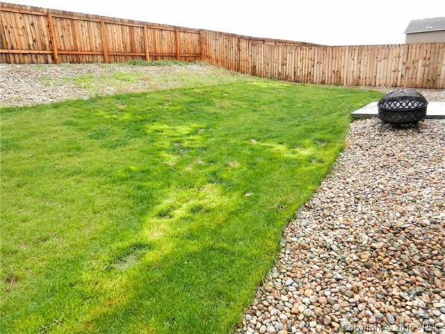 Very Large, Fully fenced backyard with sprinkler system and pati