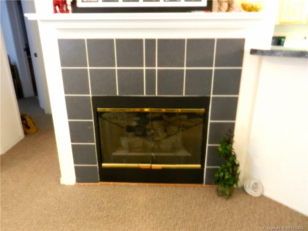 Gas fireplace with tile surround and mantle