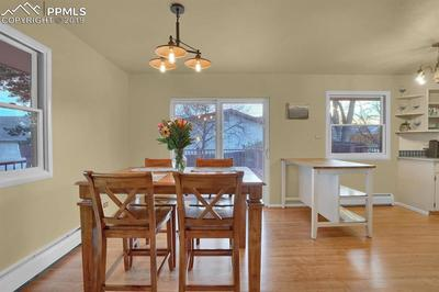 Dining area adjoining with kitchen and leading out to back deck through walkout