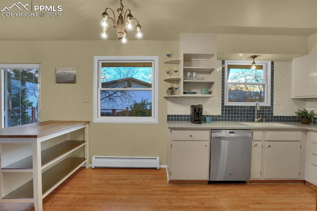 Kitchen with stainless steel appliances and views of the mountains