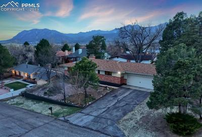 Views of front of home showing Cheyenne Mountain and the foothills