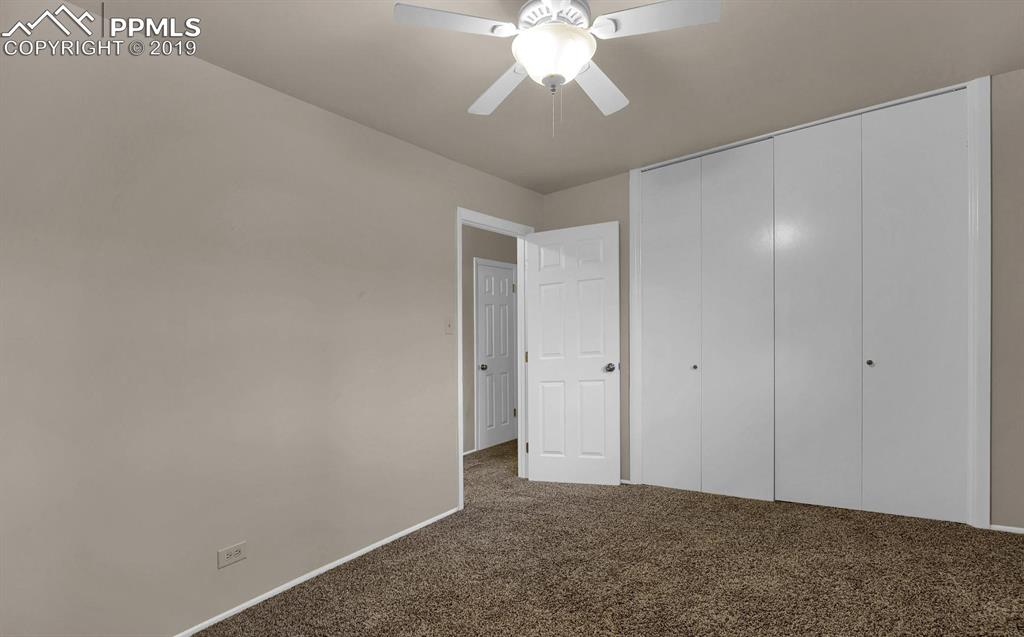 Bedroom #2 on the main floor with large closet storage
