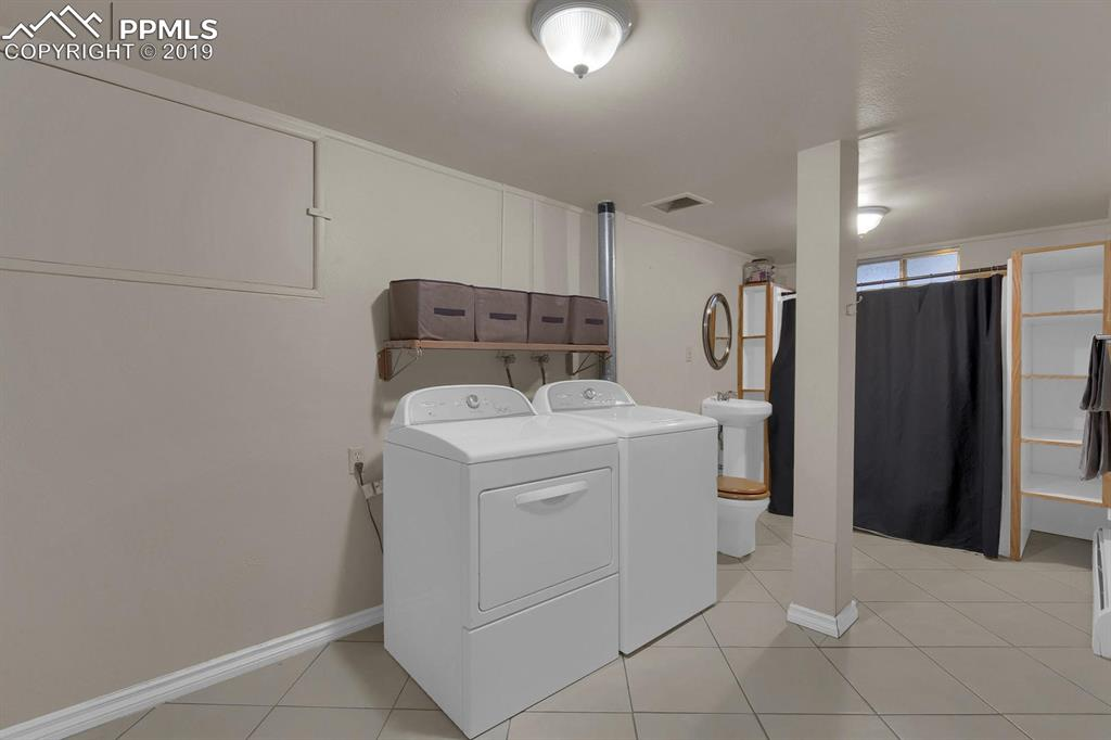 Laundry room and bathroom #3 combination in basement with laundry chute from master bedroom