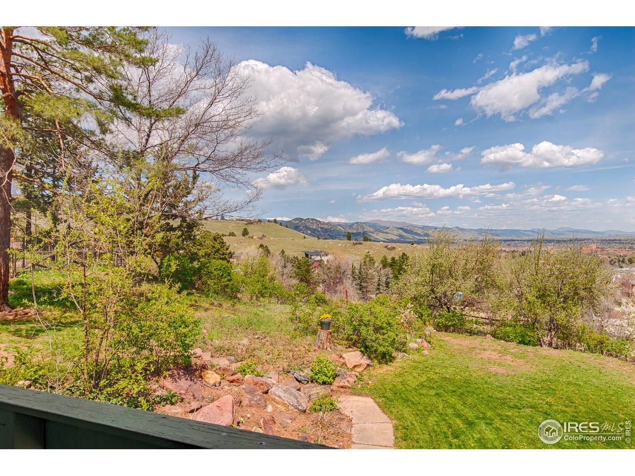 Living room deck overlooking foothills & city