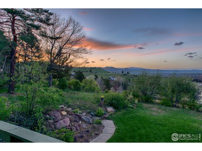 View of sunset from living room deck