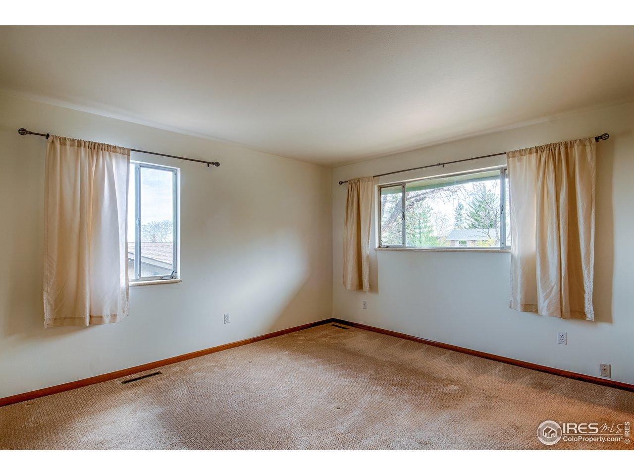 Main floor master bedroom - south & east windows