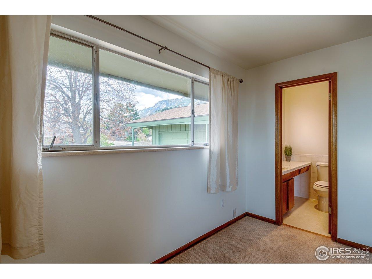 Master bedroom w/ south views & 3/4 bath