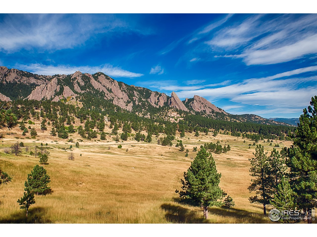 The Flatirons & miles of trails are steps away