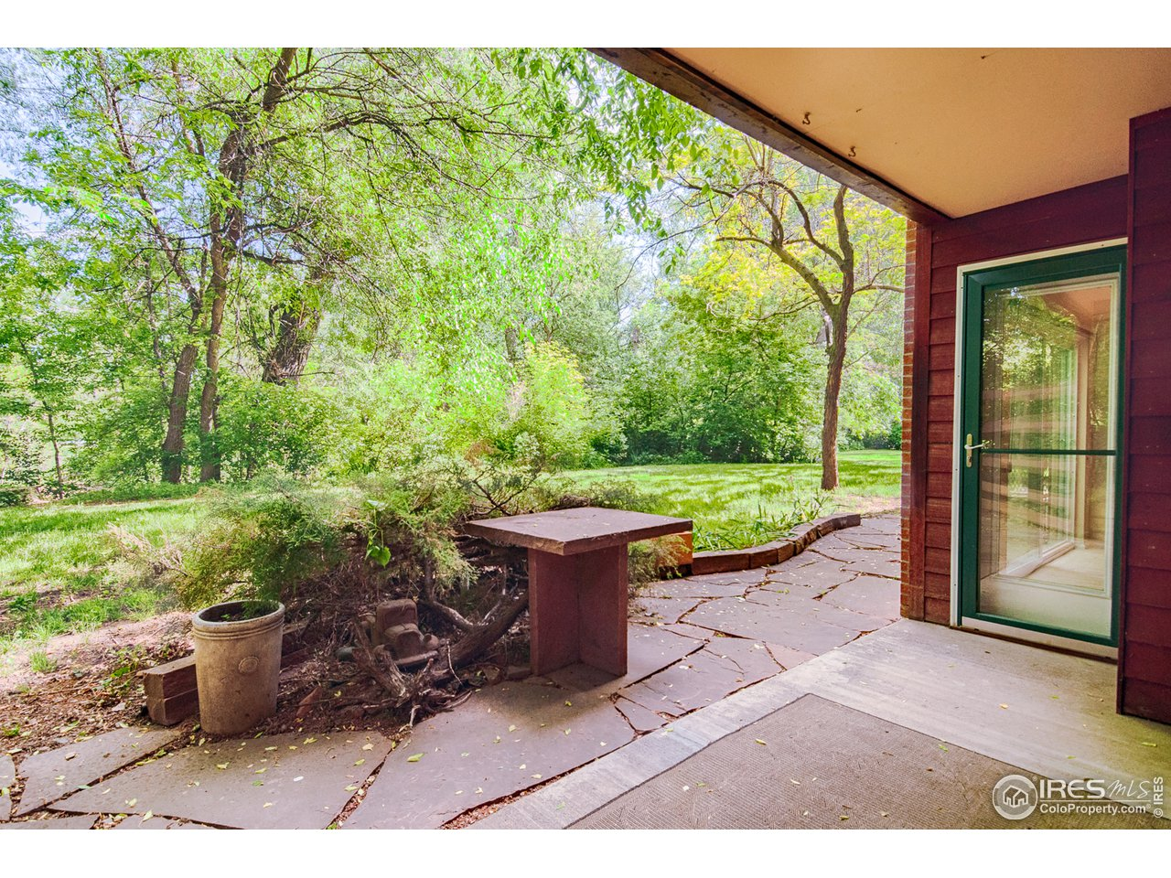 Private covered patio next to Boulder Creek