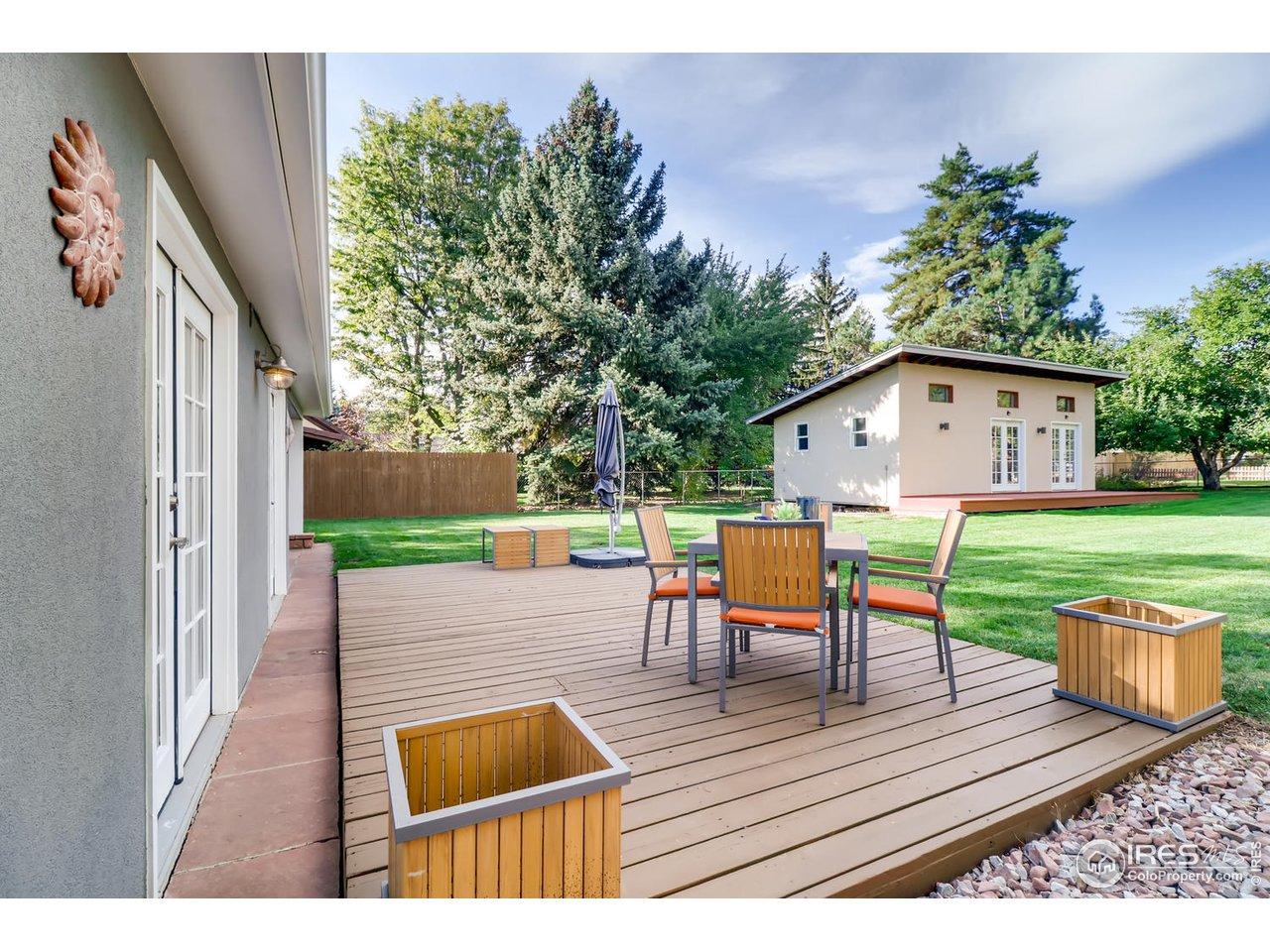 Rear patio opens to backyard oasis