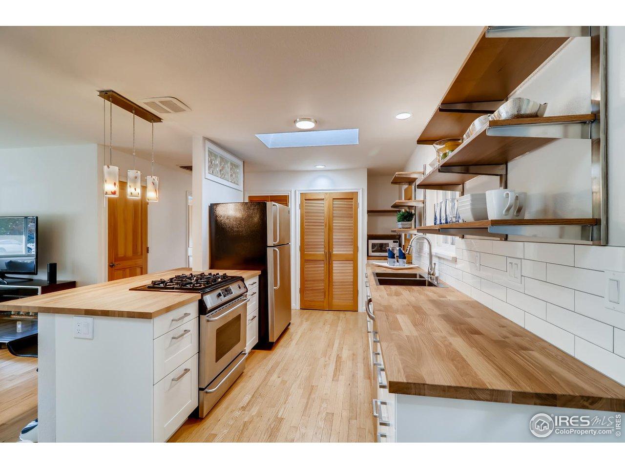 Brand new kitchen cabinets, shelving & countertops