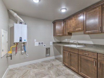 LARGE LAUNDRY WITH SINK AND ON-DEMAND HOT WATER