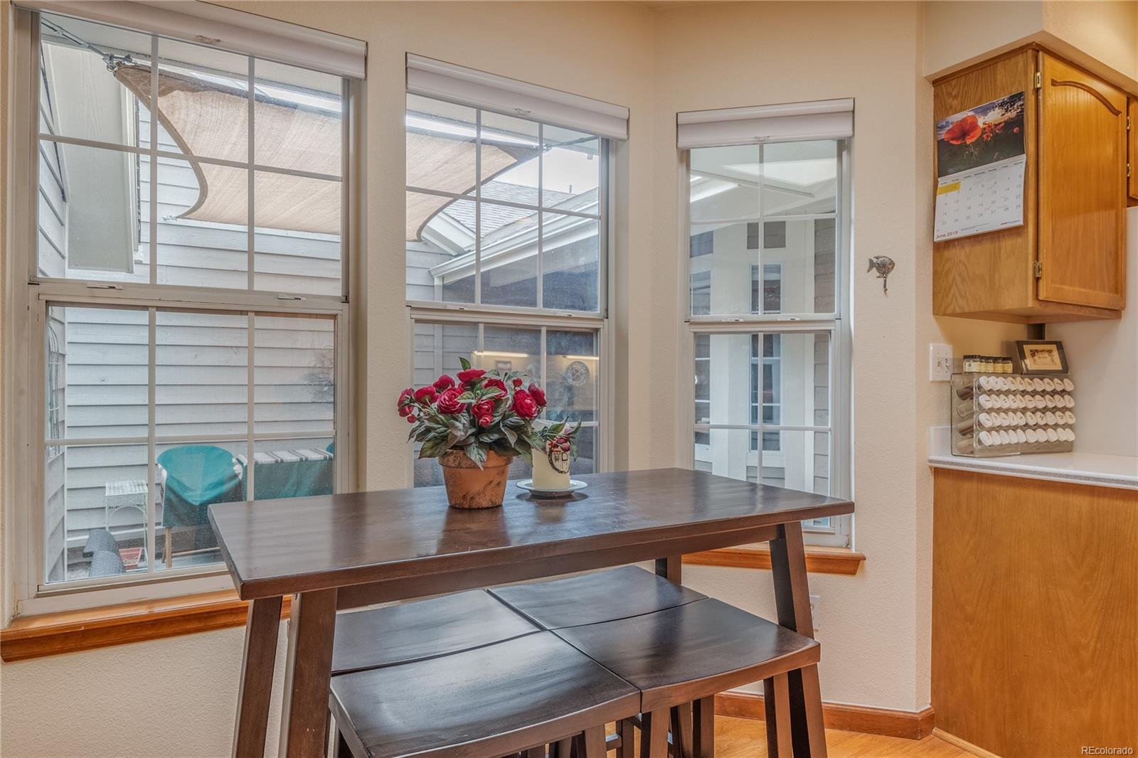Kitchen Nook - spacious & natural light, Door to Garage