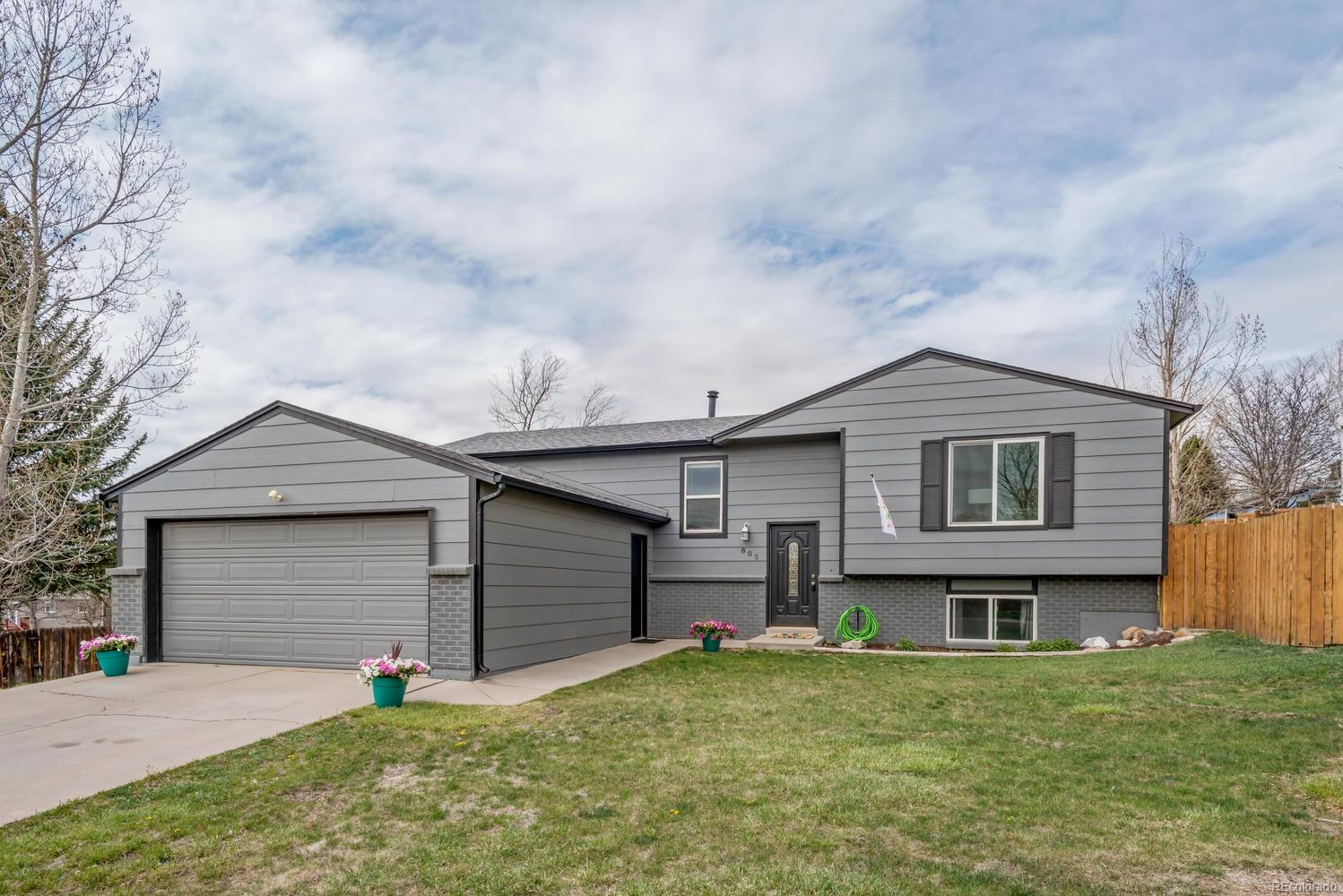 Newer exterior paint and spacious yard with RV parking.