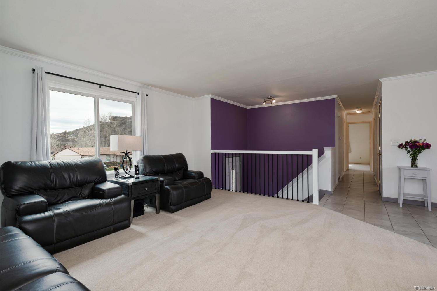 Large living room with view of Castle Rock