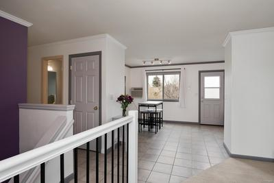 Low maintenance ceramic tile flooring, including stairs.  Upgraded banister and interior paint.